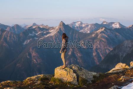 female hiker enjoying view on peak