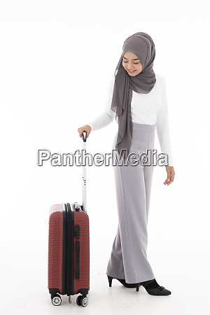 muslim girl tourist luggage