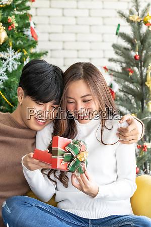 man giving girl christmas present