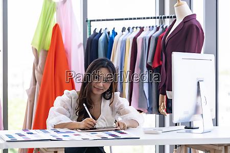 fashion designer owner sketching