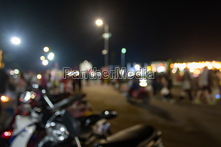 blurred motorcycle and blurred people in