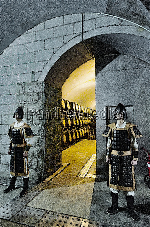 two guards in ancient costume stand