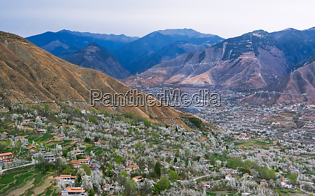tibetan village houses with farmland and