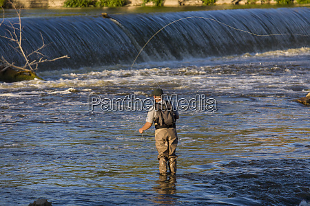 fisherman in the water at the