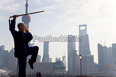 practicing tai chi with sword with