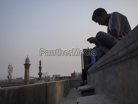 young man on a building terrace