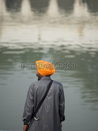 rear view of sikh man standing