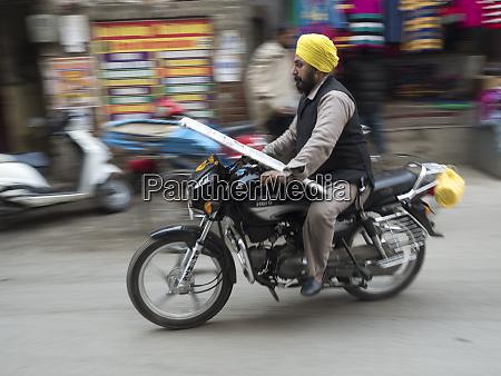 man riding motorbike in amritsar punjab