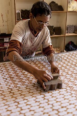 man hand printing fabric jaipur rajasthan