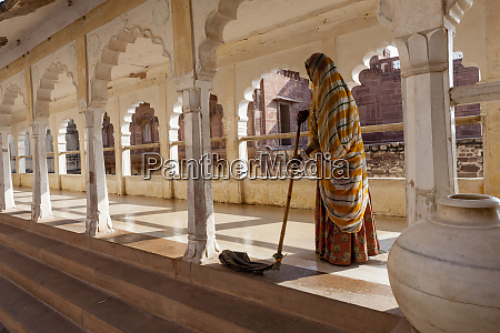 woman sweeping mehrangarh fort 10th century