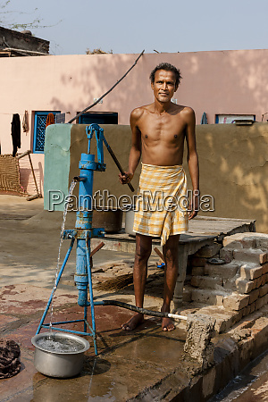 man pumping water fatehpur sikri village