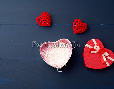open red heart shaped gift box