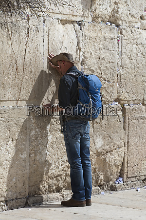 jewish worshipper in prayer at the
