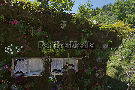 house wall decorated with flowers furano