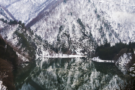 reflection of mountain covered with snow