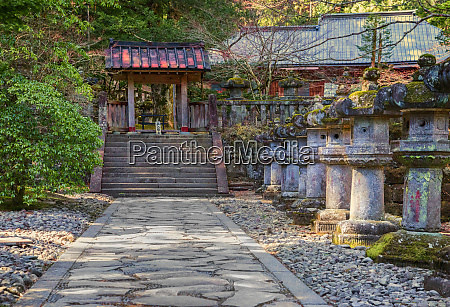 stone path leading to red japanese