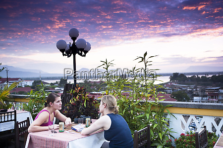 dining on a rooftop in laos