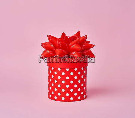 round red cardboard box in white