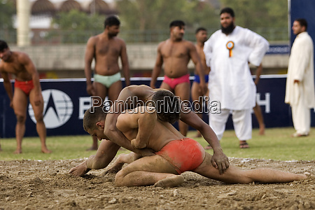 local wrestlers in a traditional match