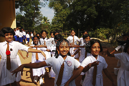 sri lanka colombo schoolchildren running in
