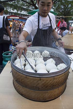 thailand chiang mai man cooking dumplings