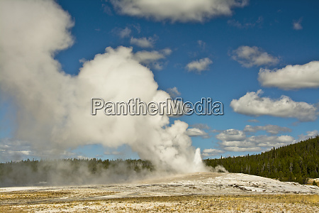 old faithful erupting yellowstone national park