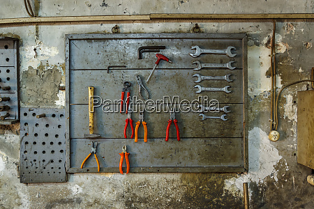 hand tools on wall in old