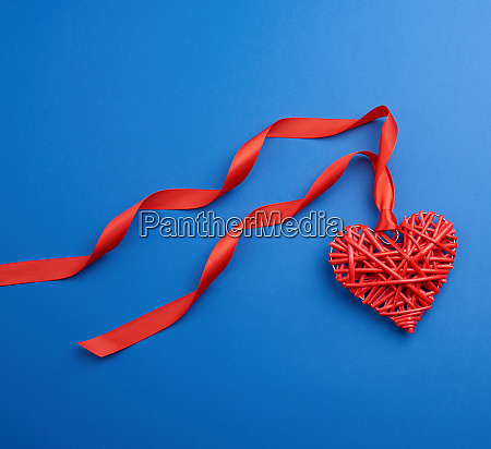 red wicker decorative heart hanging on