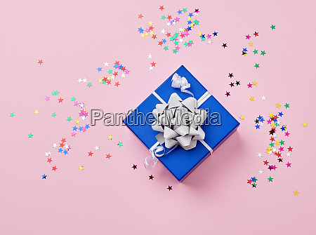 blue cardboard square box tied up