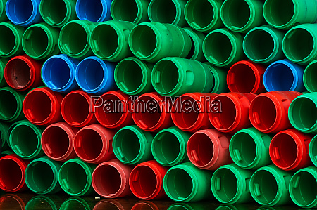 used plastic barrels blue green and