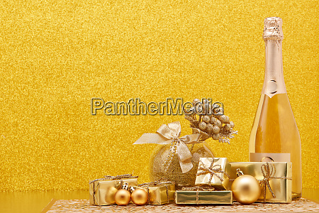 golden christmas ornaments gift boxes and