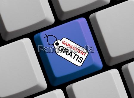 computer keyboard with tag showing guaranteed