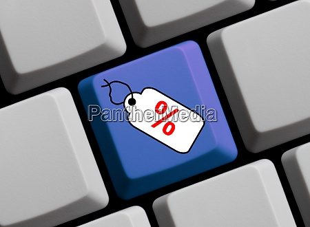 computer keyboard with tag showing special