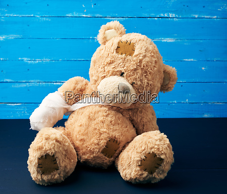 brown teddy bear with rewound white