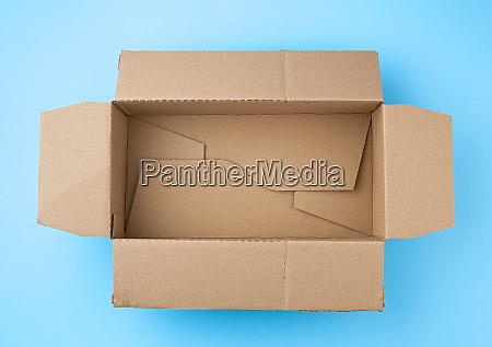 open empty square brown cardboard box