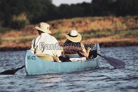 zimbabwe mana pools couple canoeing at