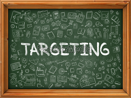 green chalkboard with hand drawn targeting