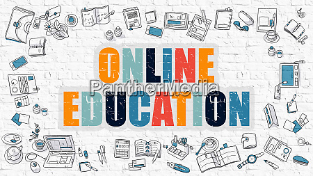 online education on white brick wall