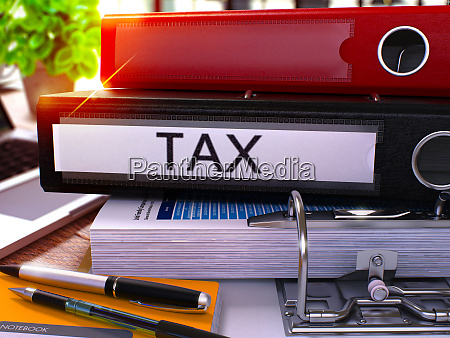 black office folder with inscription tax