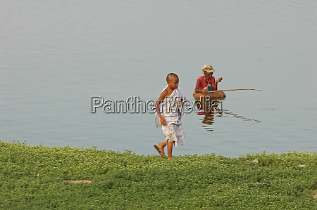 myanmar mandalay man sitting in the