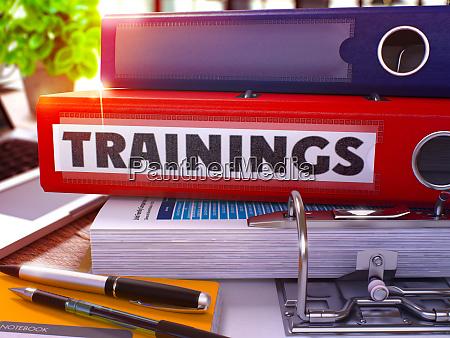 trainings on red office folder toned