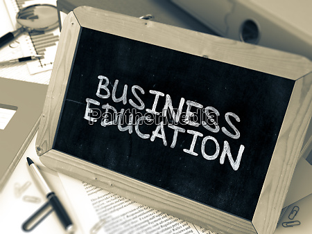 business education chalkboard with hand