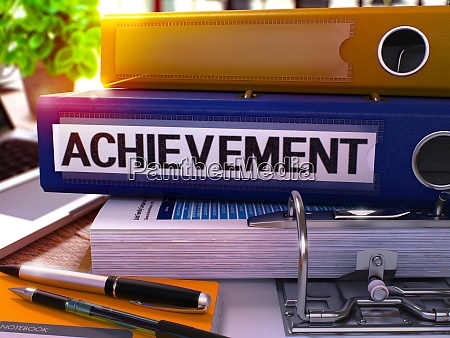 blue office folder with inscription achievement