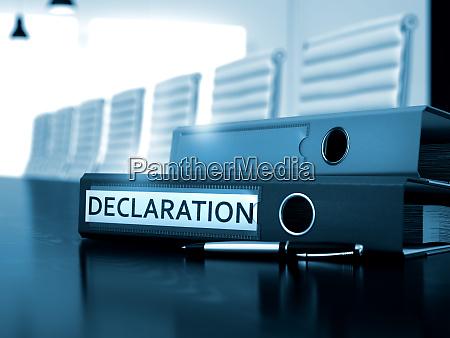 declaration on file folder blurred image