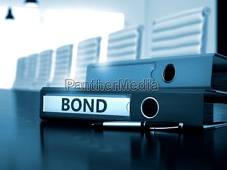 bond on office folder blurred image