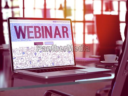 webinar on laptop in modern workplace