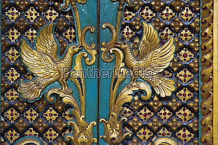 indonesia bali gilded carved temple doors