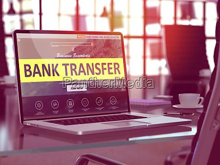 bank transfer on laptop in modern