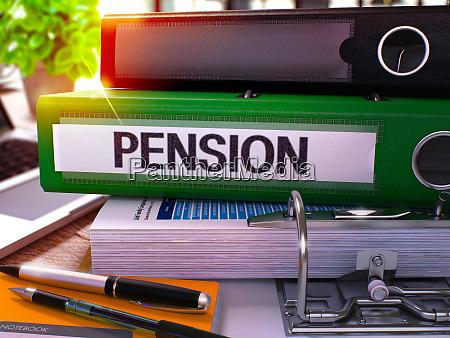 pension on green office folder toned
