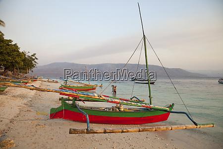 colorful catamarans on beach wetar island